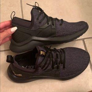 Black Puma sneakers